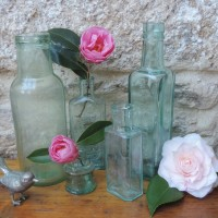 Win 5 antique glass bottles and 25% off vintage hire costs from Tresamble Trading